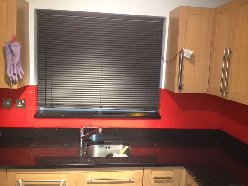 Glass splashback with a granite surface
