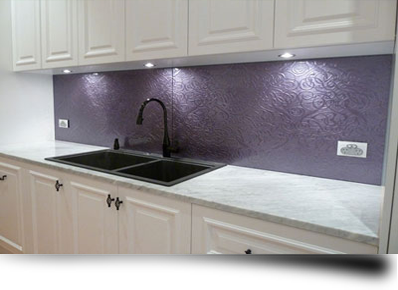 A new toughened glass kitchen splashback giving an old kitchen a makeover