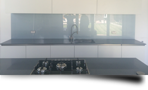 Glass splashbacks versus kitchen and bathroom tiles