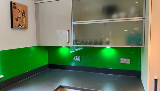 Neon apple kitchen splashback